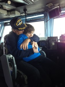 My father and younger son Eli saying goodbye to the USS Enterprise where he served.